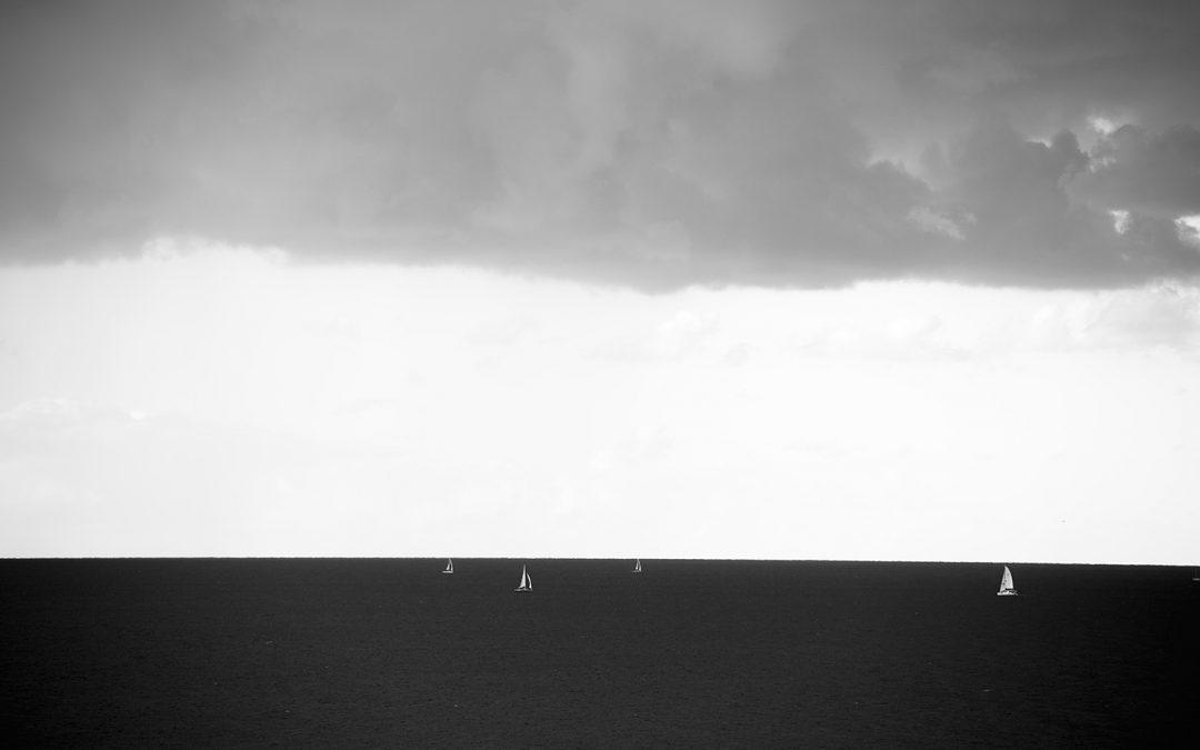 Sunset three layers sailboats